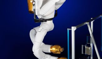 This Nov. 13, 2013 photo made available by NASA shows the Robonaut with legs at a lab in Houston. Each leg, 4 feet, 8 inches long when straight, has seven joints. Instead of feet, there are grippers. Each gripper, or foot, has a light, camera and sensor for building 3-D maps. (AP Photo/NASA, Bill Stafford, James Blair)