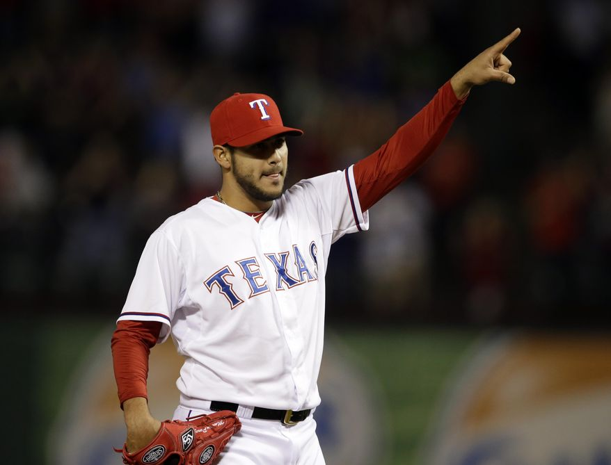 Texas Rangers' Martin Perez celebrates after getting the final out against the Chicago White Sox in a baseball game, Friday, April 18, 2014, in Arlington, Texas. Perez threw a three-hitter in the 12-0 Rangers win. (AP Photo/Tony Gutierrez)
