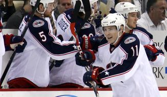 Columbus Blue Jackets' Matt Calvert (11) returns to the bench after his short-handed goal in the second period of a first-round NHL playoff hockey game against the Pittsburgh Penguins in Pittsburgh on Saturday, April 19, 2014. (AP Photo/Gene J. Puskar)