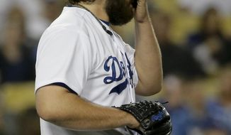 Los Angeles Dodgers relief pitcher Chris Perez wipes his face after hitting Arizona Diamondbacks' Cliff Pennington with a pitch during 12th inning of a baseball game in Los Angeles, Friday, April 18, 2014. (AP Photo/Chris Carlson)