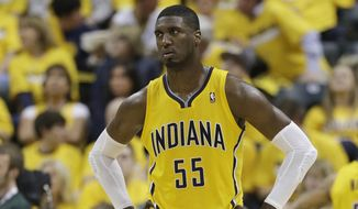 Indiana Pacers' Roy Hibbert looks at the scoreboard during the second half in Game 1 of an opening-round NBA basketball playoff series against the Atlanta Hawks, Saturday, April 19, 2014, in Indianapolis. Atlanta defeated Indiana 101-93. (AP Photo/Darron Cummings)