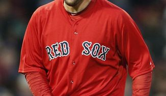 Boston Red Sox's John Lackey returns to the dugout after giving up a run in the top of the first inning of a baseball game against the Baltimore Orioles in Boston, Friday, April 18, 2014. (AP Photo/Michael Dwyer)