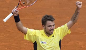 Stanislas Wawrinka of Switzerland, celebrates as he defeated David Ferrer of Spain during their semifinal match of the Monte Carlo Tennis Masters tournament in Monaco, Saturday, April 19, 2014. Wawrinka won 6-1 7-6. (AP Photo/Michel Euler)