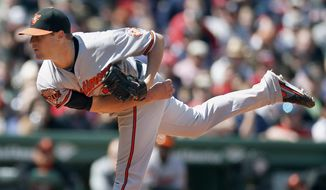 Baltimore Orioles' Bud Norris follows through on a pitch in the first inning of a baseball game against the Boston Red Sox in Boston, Saturday, April 19, 2014. (AP Photo/Michael Dwyer)