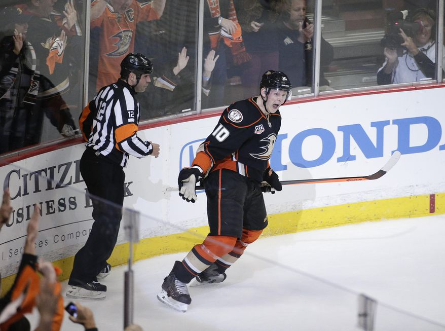 Anaheim Ducks' Corey Perry celebrates his goal against the Dallas Stars during the second period in Game 2 of a first-round NHL hockey Stanley Cup playoff series, Friday, April 18, 2014, in Anaheim, Calif. (AP Photo/Jae C. Hong)