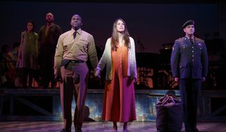 """This image released by Polk & Co. shows, foreground from left, Joshua Henry, Sutton Foster and Colin Donnell during a performance of """"Violet"""" in New York. (AP Photo/Polk & Co., Joan Marcus)"""
