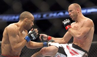 Donald Cerrone, right, and Edson Barboza, of Brazil, fight in a mixed martial arts event on Saturday, April 19, 2014, at UFC Fight Night in Orlando Fla. Cerrone won by tap out. (AP Photo/Reinhold Matay)