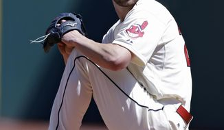 Cleveland Indians starting pitcher Corey Kluber delivers in the first inning of a baseball game against the Toronto Blue Jays, Saturday, April 19, 2014, in Cleveland. (AP Photo/Tony Dejak)