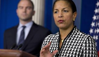 National Security Adviser Susan Rice, right, accompanied by Ben Rhodes, deputy National Security Adviser for Strategic Communications and Speechwriting, speaks about President Barack Obama's upcoming trip to Asia, Friday April 18, 2014 , at the White House briefing room in Washington.  (AP Photo/Jacquelyn Martin)