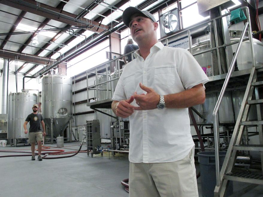 ** FILE ** In this April 12, 2014, photo, Grayton Beer Co. owner Jamey Price discusses a proposed bill that could affect Florida's craft brewing industry in Santa Rosa Beach, Fla. (AP Photo/Brendan Farrington)