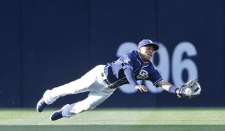 San Diego Padres center fielder Alexi Amarista makes a diving catch to rob San Francisco Giants' Hunter Pence in the first inning of a baseball game Saturday, April 19, 2014, in San Diego.  (AP Photo/Lenny Ignelzi)
