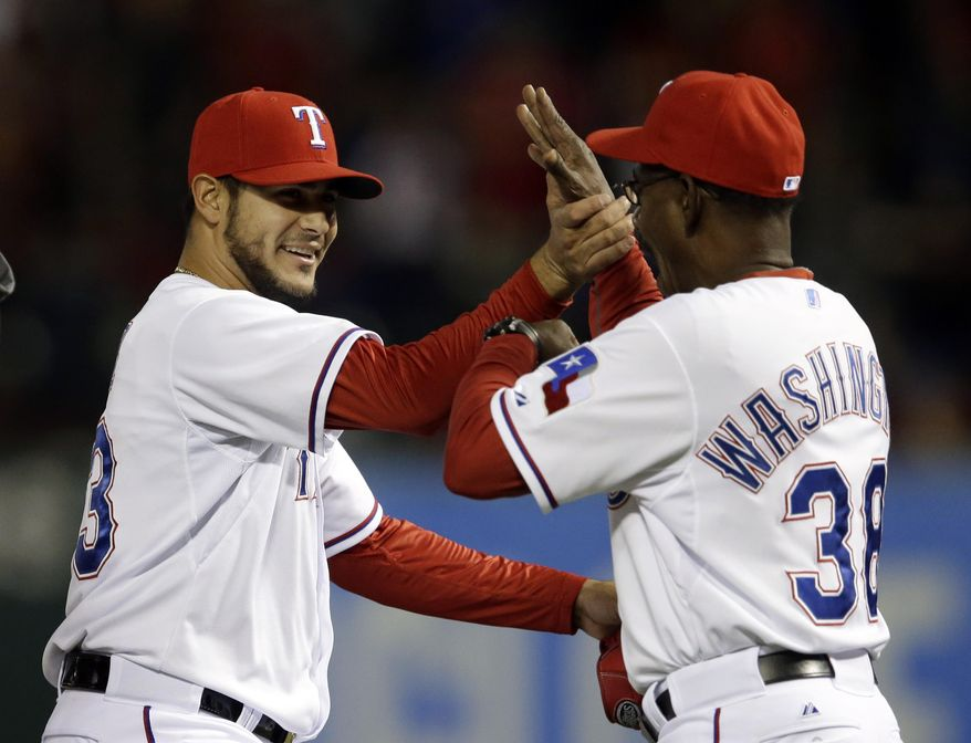 Texas Rangers' Martin Perez is congratulated by manager Ron Washington (38) following a baseball game against the Chicago White Sox, Friday, April 18, 2014, in Arlington, Texas. Perez pitched a three-hitter in the 12-0 Rangers win. (AP Photo/Tony Gutierrez)