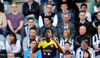 Swansea City's Wilfried Bony celebrates his goal  during their English Premier League soccer match against Newcastle United at St James' Park, Newcastle, England, Saturday, April 19, 2014. (AP Photo/Scott Heppell)