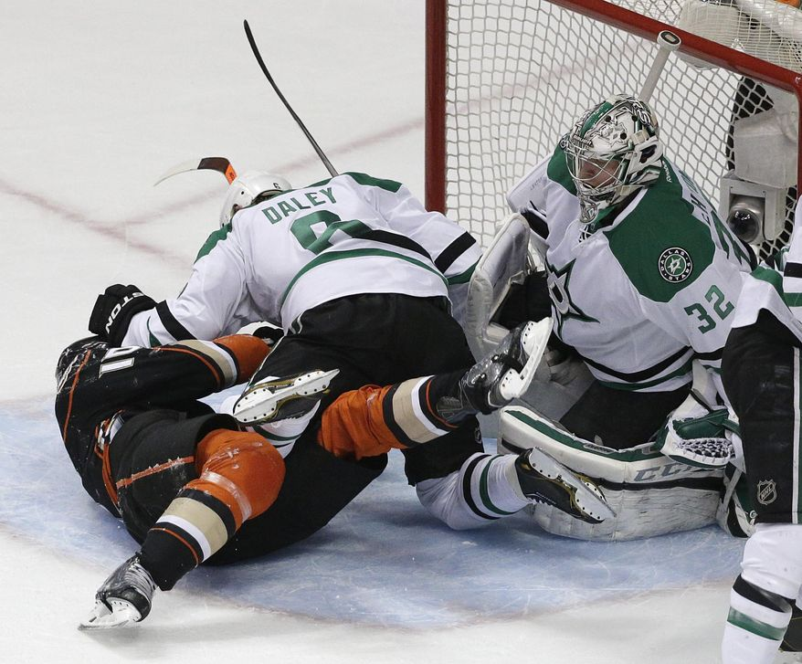 Dallas Stars' Trevor Daley (6) fights with Anaheim Ducks' Corey Perry (10) in front of Stars goalie Kari Lehtonen, of Finland, during the first period in Game 2 of the first-round NHL hockey Stanley Cup playoff series on Friday, April 18, 2014, in Anaheim, Calif. (AP Photo/Jae C. Hong)