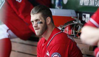dWashington Nationals' Bryce Harper sits on the bench during the fourth inning of a baseball game against the St. Louis Cardinals at Nationals Park on Saturday, April 19, 2014, in Washington. The Cardinals won 4-3. Harper was pulled early from a game after Washington manager Matt Williams said the young outfielder didn't hustle. Harper was taken out after six innings. The 21-year-old Harper is a two-time All-Star known for his aggressive play. But in the sixth inning, he hit the ball to the mound, jogged to first and took a right turn to the dugout before getting halfway down the basepath. (AP Photo/Alex Brandon)