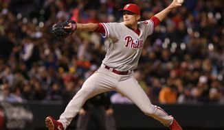 Philadelphia Phillies relief pitcher Jake Diekman works against the Colorado Rockies in the eighth inning of the Rockies' 3-1 victory in a baseball game in Denver on Saturday, April 19, 2014. (AP Photo/David Zalubowski)