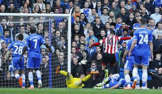 Sunderland's Connor Wickham, no. 10, celebrates scoring against Chelsea during their English Premier League soccer match at the Stamford Bridge ground in London, Saturday April 19, 2014. (AP Photo/Lefteris Pitarakis)
