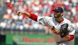 St. Louis Cardinals starting pitcher Lance Lynn throws during the first inning of a baseball game against the Washington Nationals at Nationals Park on Saturday, April 19, 2014, in Washington. (AP Photo/Alex Brandon)