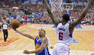 Golden State Warriors guard Stephen Curry, left, puts up a shot as Los Angeles Clippers center DeAndre Jordan defends during the first half in Game 1 of an opening-round NBA basketball playoff series, Saturday, April 19, 2014, in Los Angeles. (AP Photo/Mark J. Terrill)