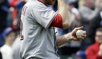 Cincinnati Reds starter Tony Cingrani wipes his face after Chicago Cubs' Mike Olt hit a solo home run during the second inning of a baseball game in Chicago, Saturday, April 19, 2014. (AP Photo/Nam Y. Huh)