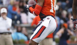 Auburn quarterback Nick Marshall drops back to throw in the first half of the NCAA college football team's A Day spring game Saturday, April 19, 2014 in Auburn, Ala.  (AP Photo/John Bazemore)