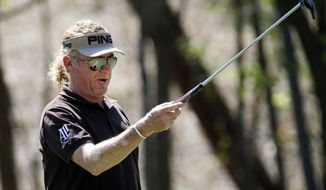 Miguel A. Jimenez reacts after missing a putt for an eagle on the 10th hole during the final round of play in the Greater Gwinnett Championship golf tournament of the Champions Tour, Sunday, April 20, 2014 in Duluth, Ga. (AP Photo/John Bazemore)