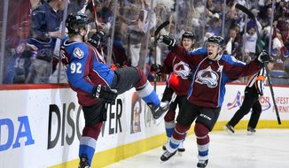 Colorado Avalanche left wing Gabriel Landeskog (92), from Sweden, celebrates his goal against the Minnesota Wild with teammates Paul Stastny (26) and Nathan MacKinnon (29) in the second period of Game 2 of an NHL hockey first-round playoff series on Saturday, April 19, 2014, in Denver. (AP Photo/Jack Dempsey)