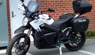 ADVANCE FOR MONDAY APRIL 21 AND THEREAFTER This Wednesday April 9, 2014  photo provided by the Saltville Police Department shows a new Zero Motorcycle outside the Departments headquarters in Saltville, Va. The agency recently acquired the 100 percent electric cycle with settlement funds that came from a case involving Abbott Pharmacueticals. (AP Photo/Brisol Herald Courier, Saltville Police Department)