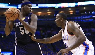 Memphis Grizzlies forward Zach Randolph (50) faces the basket as Oklahoma City Thunder center Kendrick Perkins (5) defends during the first quarter of Game 1 of the opening-round NBA basketball playoff series in Oklahoma City on Saturday, April 19, 2014. (AP Photo/Alonzo Adams)