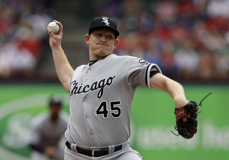 Chicago White Sox's Erik Johnson works against the Texas Rangers in the first inning of a baseball game on Sunday, April 20, 2014, in Arlington, Texas. (AP Photo/Tony Gutierrez)