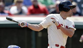 Cleveland Indians' David Murphy hits a three-RBI double off Toronto Blue Jays relief pitcher Aaron Loup in the sixth inning of a baseball game, Sunday, April 20, 2014, in Cleveland. Carlos Santana, Michael Brantley and Asdrubal Cabrera scored. (AP Photo/Tony Dejak)