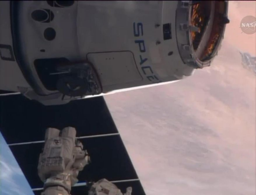 This frame grabbed image from NASA-TV Sunday April 20, 2014 shows the SpaceX Dragon resupply capsule just prior to being captured by the Canadarm2 from the International Space Station at 7:14 a.m. EDT Sunday. (AP Photo/NASA-TV)