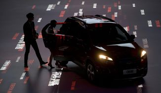 Brand ambassador Taiwanese actor Kai Ko, left and Amber Kuo  step  into a Chevrolet Trax urban SUV during the China launch of the car ahead of Auto China 2014 in Beijing, China, Saturday, April 19, 2014. The Trax will go on sale in China starting at RMB 119,900 or $19,300. (AP Photo/Ng Han Guan)