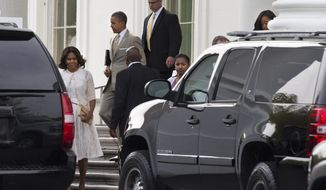 First lady Michelle Obama, left, walks with President Barack Obama, and daughters Sasha and Malia, both partially obscured, from the White House to a motorcade to attend Easter services on Sunday, April 20, 2014, in Washington. The first family attended services at the Nineteenth Street Baptist Church in Washington. (AP Photo/Jacquelyn Martin)