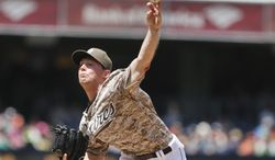 San Diego Padres starting pitcher Robbie Erlin works against the San Francisco Giants in the first inning of a baseball game on Sunday, April 20, 2014, in San Diego. (AP Photo/Lenny Ignelzi)