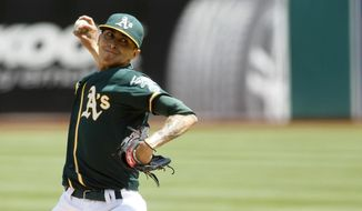 Oakland Athletics pitcher Jesse Chavez delivers a pitch during a baseball game against the Houston Astros in Oakland, Calif. on Sunday, April 20, 2014. (AP Photo/Matthew Sumner)