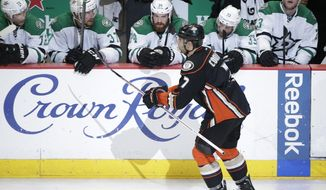 Anaheim Ducks' Andrew Cogliano(7) celebrates his goal as he skates past the Dallas Stars players during the third period in Game 2 of the first-round NHL hockey Stanley Cup playoff series on Friday, April 18, 2014, in Anaheim, Calif. The Ducks won 3-2. (AP Photo/Jae C. Hong)