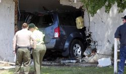 This image provided by Tony Cheval shows the scene of an accident Sunday April 20, 2014 where an alleged drunk driver ran into the home killing a 16-year-old girl in Palmdale, Calif. A Sheriff's Department spokesman said that 20-year-old Roberto Rodriguez of Palmdale allegedly crashed his Nissan Pathfinder into the corner of an apartment building at 3:50 a.m. Sunday. When deputies arrived they found the SUV embedded in the building and the girl dead inside. (AP Photo/Tony Cheval)