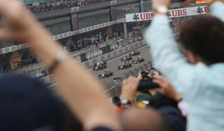 Mercedes driver Lewis Hamilton of Britain leads at the start of the Chinese Formula One Grand Prix at Shanghai International Circuit in Shanghai, Sunday, April 20, 2014. (AP Photo/Eugene Hoshiko)