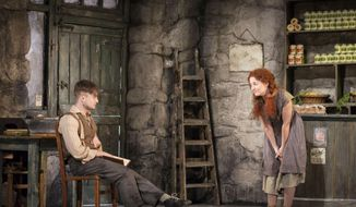 "This image released by Boneau/Bryan-Brown shows Daniel Radcliffe, left, and Sarah Green performing in ""The Cripple of Inishmaan,"" opening April 20 at the Cort Theatre in New York. (AP Photo/Boneau/Bryan-Brown, Johan Persson)"