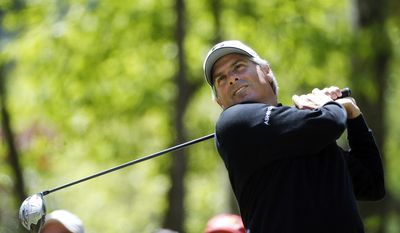 Fred Couples watches his tee shot on the third hole during the final round of play in the Greater Gwinnett Championship golf tournament  of the Champions Tour, Sunday, April 20, 2014, in Duluth, Ga. (AP Photo/John Bazemore)