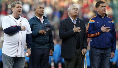 Founder of The One Fund Jim Gallagher, left, Massachusetts Gov. Deval Patrick, center left, former Boston mayor Tom Menino, center right, and current mayor Marty Walsh, right, stand on the field at Fenway Park for the playing of the national anthem during ceremonies marking the one-year anniversary of the Boston Marathon bombings before a baseball game between the Boston Red Sox and the Baltimore Orioles in Boston, Sunday, April 20, 2014. (AP Photo/Michael Dwyer)