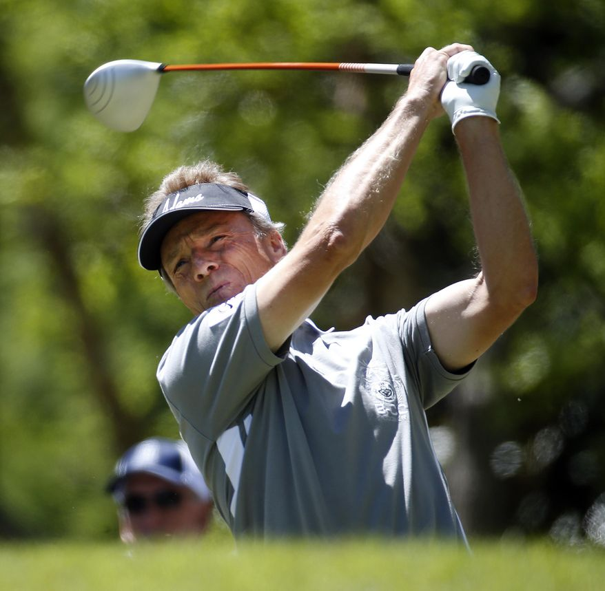 Bernhard Langer hits from the tee on the third hole during the final round of play in the Greater Gwinnett Championship golf tournament of the Champions Tour, Sunday, April 20, 2014, in Duluth, Ga. (AP Photo/John Bazemore)