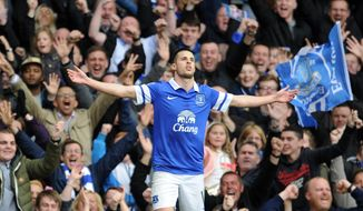 Everton's Kevin Mirallas celebrates after he scores the second goal of the game for his side during their English Premier League soccer match against Manchester United at Goodison Park in Liverpool, England, Sunday April 20, 2014. (AP Photo/Clint Hughes)