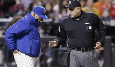 New York Mets manager Terry Collins argues a call with home plate umpire Eric Cooper during the third inning of a baseball game against the Atlanta Braves on Saturday, April 19, 2014, in New York. (AP Photo/Frank Franklin II)