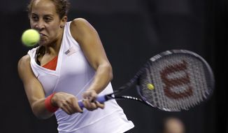 United States' Madison Keys returns a ball to France's Caroline Garcia during a Fed Cup singles world group playoff tennis match Sunday, April 20, 2014, in St. Louis. Garcia won 6-4, 6-3.(AP Photo/Jeff Roberson)