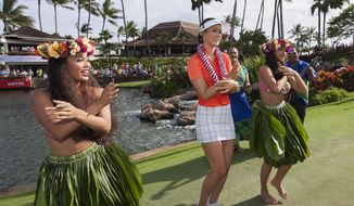 ** FILE ** Michelle Wie, center, dances the hula after winning the 2014 LPGA LOTTE Championship golf tournament at Ko Olina Golf Club, Saturday, April 19, 2014, in Kapolei, Hawaii. (AP Photo/Eugene Tanner)