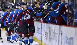 Colorado Avalanche center Nathan MacKinnon (29) celebrates a goal against the Minnesota Wild in the first period of Game 2 of an NHL hockey first-round playoff series on Saturday, April 19, 2014, in Denver. (AP Photo/Jack Dempsey)