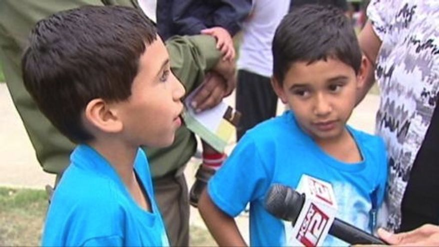 Twin boys, 7, are being credited with fighting off a carjacker, who took off with them in their family's vehicle as it was sitting in their San Antonio driveway. (ABC News)