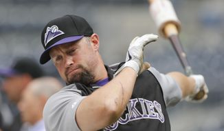 Colorado Rockies' Michael Cuddyer warms up for batting practice as the Rockies prepare to play the San Diego Padres in a baseball game Thursday, April 17, 2014, in San Diego. (AP Photo/Lenny Ignelzi)